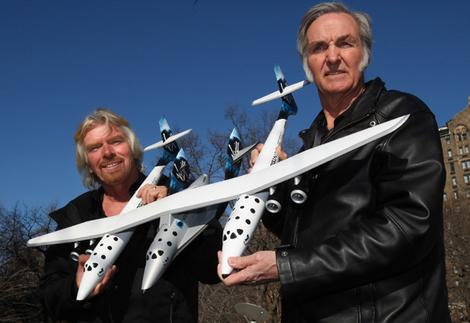 Sir Richard Branson (L), and Burt Rutan (R), CEO of Scaled Composites, with a model of WhiteKnightTwo